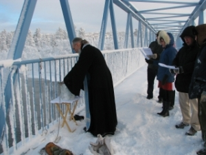 Fr. John Bingham, together with members of the St. Nikolai Mission community, blessing the Yukon River, Theophany 2009.