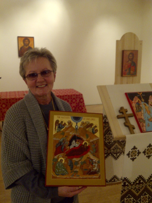 Our sister in Christ, Valerie, holds the Nativity icon she gave as a gift to the Mission